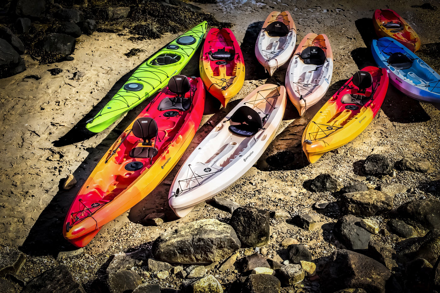 Beached Pod Of Kayaks