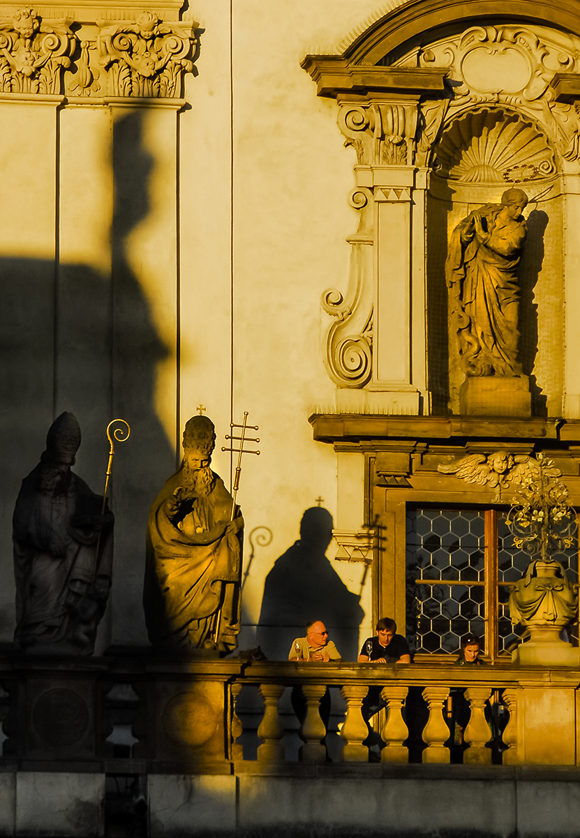 Tourists having a drink in the warm late afternoon sun in Prague.